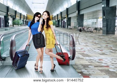 Modern Girls Standing In Airport Hall