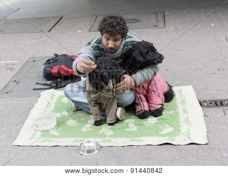Beggar With Dogs On The Ground