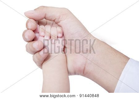 Small Baby Hand On The Father Palm