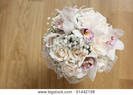 White roses and orchids in bouquet