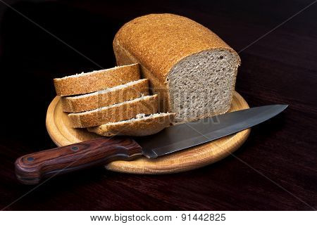 Sliced loaf of bread on black background