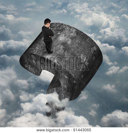Man Standing On Huge 3D Concrete Question Mark Sky Clouds