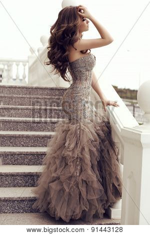 Sensual Woman With Long Dark Hair In Luxurious Sequin Dress