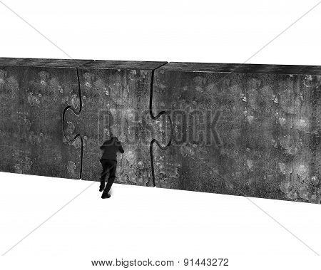 Businessman Pushing Huge Puzzle Door Of Concrete Wall