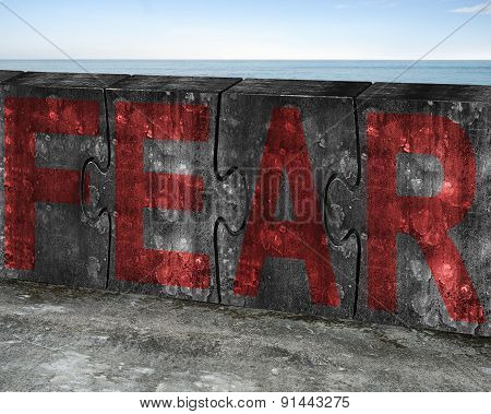 Red Fear Word On Huge Concrete Puzzles With Sea Background