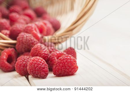 strawberries in a basket on the table in the garden