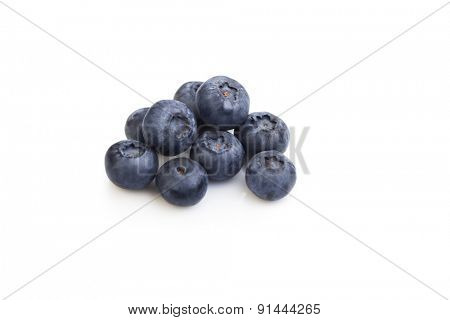 heap ripe sweet blueberries isolate on white