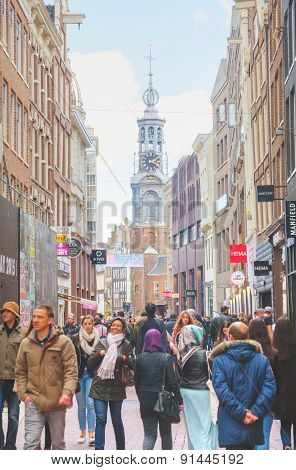 Narrow Street Of Amsterdam Crowded With Tourists