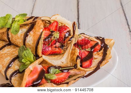 Homemade Crepes With Strawberries And Chocolate Syrup