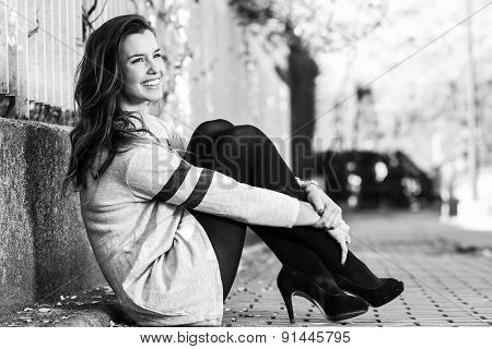 Funny Female Model Of Fashion With High Heels Sitting On The Floor