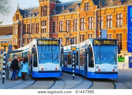 Trams At The Amsterdam Centraal Railway Station In Amsterdam, Netherlands