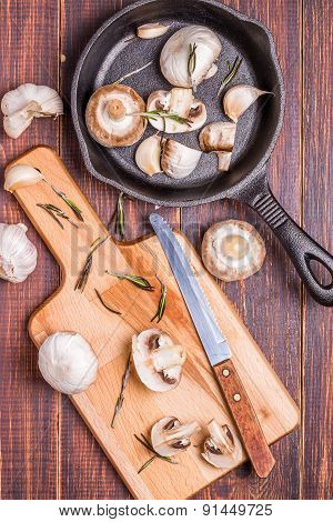 Mushrooms On A Cutting board