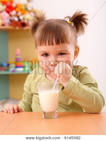 Happy Little Girl Drinks Milk