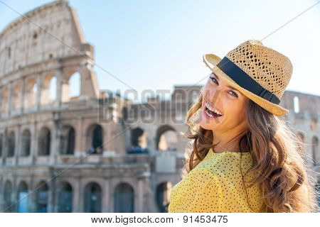 Portrait Of Laughing Woman At Colosseum In Rome In Summer