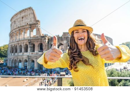 Smiling Woman Giving Two Thumbs Up At Colosseum In Rome