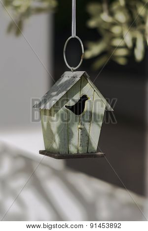 Decorative Birdhouse In Vintage Style On The Branch Of An Olive Tree