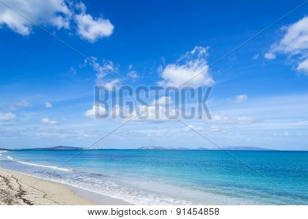 Fiume Santo Beach Under Soft Clouds