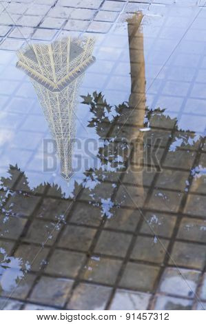 Paris Reflected In A Puddle