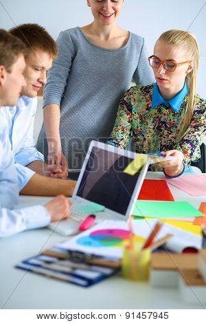 Young business people working at office on new project.
