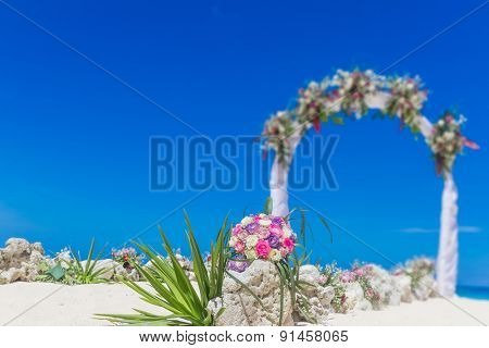 beach wedding venue, wedding setup, cabana, arch, gazebo decorated with flowers, beach wedding setup