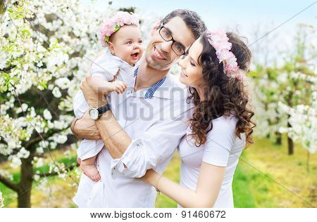 Happy family in a blossom garden