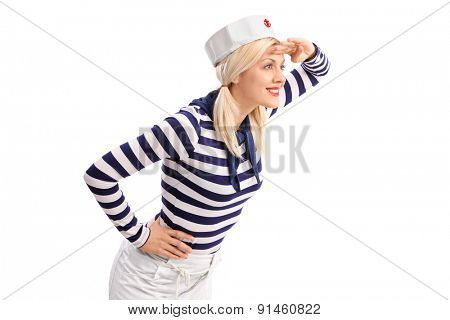 Young female sailor shading her eyes and looking in the distance isolated on white background