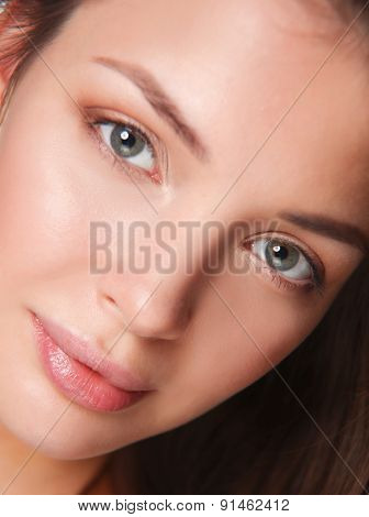 Portrait of beautiful young woman face. Isolated on white background.