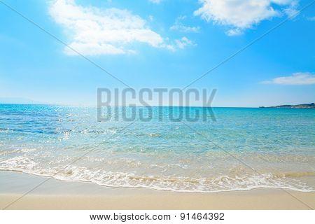 Le Bombarde Shoreline Under A Blue Sky
