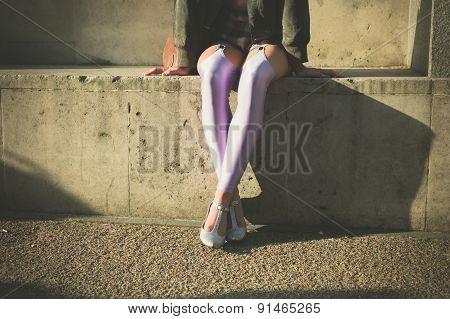 Woman In Leggins Sitting Outside