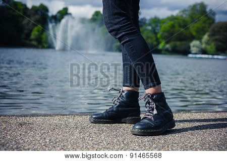 Legs Of Woman By Pond In Park