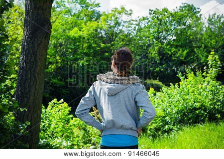 Woman Standing By Tree In Park