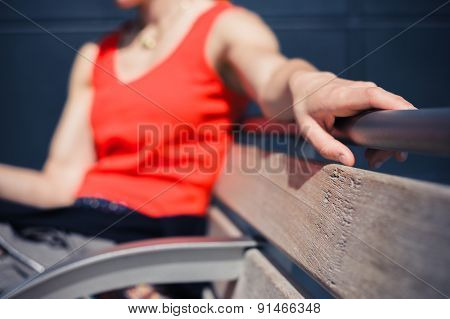 Woman Resting On A Bench