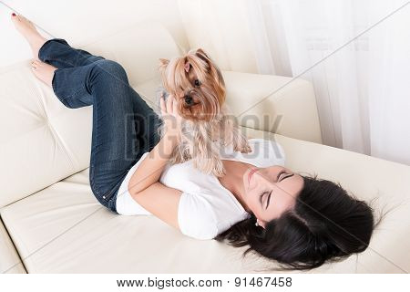 Beautiful Young Brunette Girl Playing With Her Dog