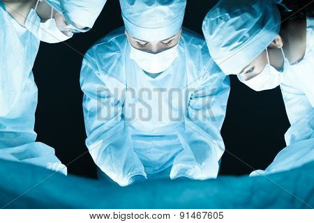 Medical Team Performing Operation