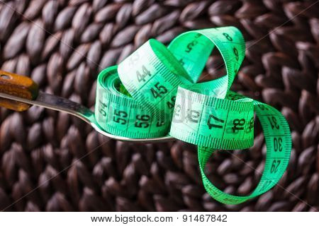 Green Measuring Tape On Kitchen Spoon