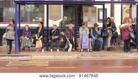 Waiting at a bus stop