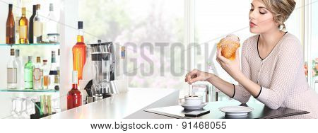 Beautiful Woman Having Breakfast In A Cafe, With Croissant And Cappuccino