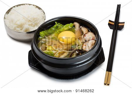 Soup of Chinese cabbage, mushrooms, pork and vegetables with raw egg. From a series of Food Korean cuisine.