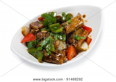 Fried pork ribs with sweet peppers and onions in the sauce. From a series of Food Korean cuisine.