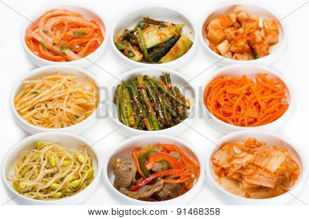 Spicy salads of traditional Korean cuisine: soy sprouts, bamboo shoots, chicken ventricles, chimchi, raw potatoes, carrots, boiled squid, cucumbers and zucchini.