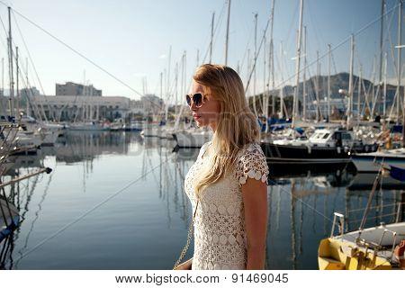 Beautiful Blonde Girl Posing At Sunny Day.