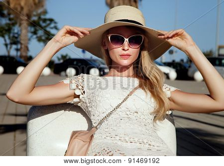 Girl Posing In Hat And Sunglasses.