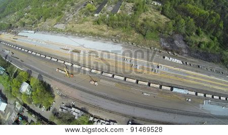 MOSCOW, RUSSIA - APR 30, 2014: People work with trucks and cranes on construction site of railroad beltway widening for passenger traffic opening. Aerial view