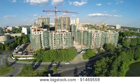 RUSSIA, MOSCOW - MAY 23, 2014: Car traffic near building site of dwelling complex Vinogradny at spring sunny day. Aerial view