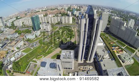 RUSSIA, MOSCOW - MAY 16, 2014: Cityscape with skyscraper in business complex at spring sunny day. Aerial view.