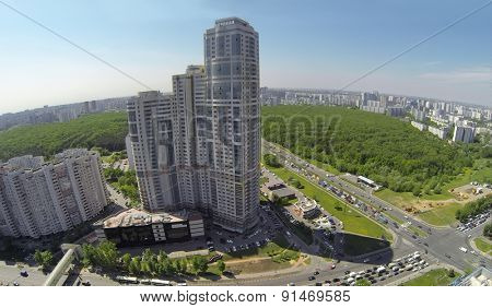 RUSSIA, MOSCOW - MAY 16, 2014: Townscape with crossroad traffic near tall dwelling complex Well House at spring sunny day. Aerial view.