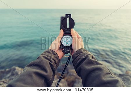 Traveler With A Compass On Coast