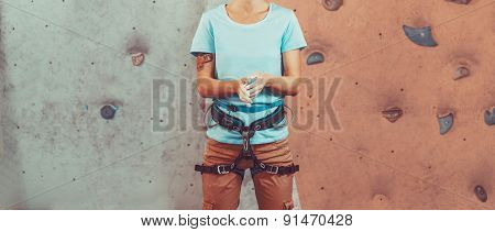 Climber Woman Coating Her Hands In Magnesia