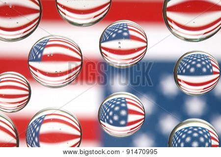 American flag reflected in water drops background