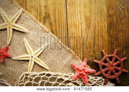 Sea stars on sackcloth on wooden background